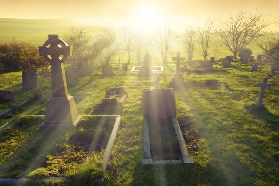 Heavenly light shining upon a old graveyard